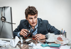 Drunk businessman sitting drunk at office Stock Image