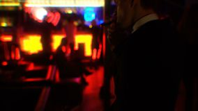 Drunk businessman smoking cigar at nightclub party, double vision effect