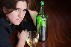 Drunk , depressed and lonely beautiful woman Stock Images