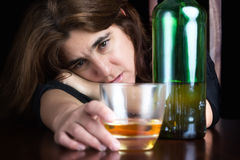 Drunk and depressed lonely woman Royalty Free Stock Photography