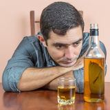 Drunk and depressed young man Royalty Free Stock Photography