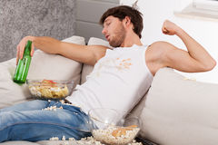 Drunk dirty man on a couch Royalty Free Stock Photo