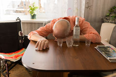 Drunk Disable Old Man Sleeping on the Table Stock Photo