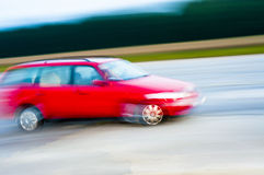 Drunk driver. An abstract image of drunk driver driving red car Royalty Free Stock Image