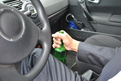 Drunk driver with bottle. In his hand Royalty Free Stock Images