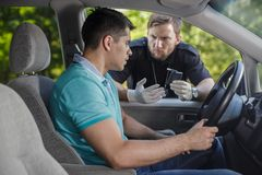 Drunk driver and cop Stock Image