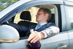 Drunk driver fell asleep at the wheel of the car Stock Photo