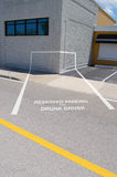 Drunk driver reserved parking. Reserved parking for drunk driver spot which is painted into the corner of a building showing the dangers of driving while drunk Royalty Free Stock Images