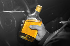 Drunk driver,social problem concept. Whiskey in hand and driving,social problem concept Stock Images