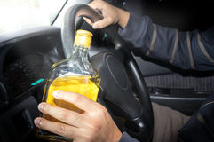 Drunk driver,social problem concept. Whiskey in hand and driving,social problem concept Royalty Free Stock Photos