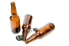 Drunk Driving. Concept image of drunk driving, with keys and empty beer bottles and the props Royalty Free Stock Photo