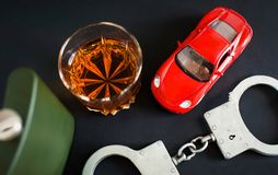 Drunk driving. Alcohol, car, handcuffs stock photo