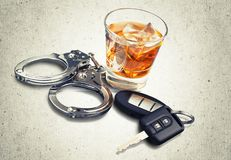 Drunk driving. Alcoholism alcohol police handcuffs key whisky royalty free stock images