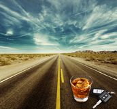 Drunk driving. Alcoholism alcohol police handcuffs key whisky Stock Photography