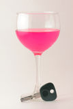 Drunk Driving. Car keys with a glass of wine to reference and bring awareness to the effects of drunk driving Royalty Free Stock Photography