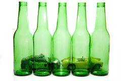 Drunk Driving Concept. Car pulled over by police behind beer bottles Royalty Free Stock Photo