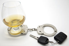 Drunk Driving Concept. Alcohol, Handcuffs and Keys  - Drunk Driving Concept Stock Images