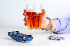 Drunk Driving Concept. Beer, Keys and Handcuffs Royalty Free Stock Photo