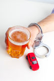 Drunk Driving Concept. Beer, Keys and Handcuffs Royalty Free Stock Photos