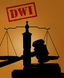 Drunk driving concept. Court gavel and scales with DWI text -- Driving while intoxicated concept Stock Photography