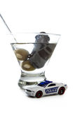 Drunk driving concept. DUI concept. Image of a drunk driving accident with a vodka martini  isolated on a white background Royalty Free Stock Image