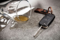 Drunk driving concept. Spilled beer and car keys on a table Stock Photos