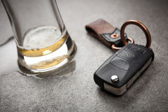 Drunk driving concept. Spilled beer and car keys on a table Stock Images