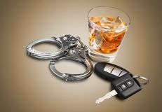 Drunk driving. Alcoholism alcohol police handcuffs key whisky Royalty Free Stock Photos