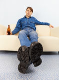Drunk dude sprawled on couch Royalty Free Stock Image