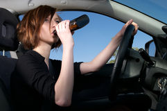 Drunk female driver Royalty Free Stock Image