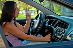 Drunk female driver Royalty Free Stock Photography