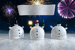 Drunk funny snowmen with banner. Frozen snowmen drink champagne with fireworks in background Stock Photography