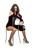 Drunk girl on a chair Stock Photography