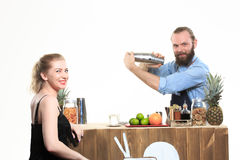 Drunk girl clings to the bartenders. Royalty Free Stock Image