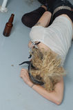 Drunk girl on the floor (focus on head & left hand) Royalty Free Stock Photo