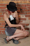 Drunk girl with hat. The party is almost finished for this beautiful woman Stock Photo