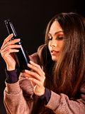 Drunk girl holding bottle of vodka. Stock Photo