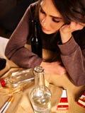 Drunk girl holding bottle of vodka Royalty Free Stock Photography