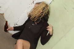 Drunk girl near the elevator Stock Photos