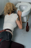 Drunk girl in a public toilet 2 Stock Images