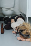 Drunk girl in a public toilet 5 (focus on head & left hand). Simulation with real punk girl Stock Photography