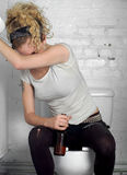 Drunk girl in a public toilet 6. Simulation with real punk girl Royalty Free Stock Photo