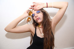 Drunk girl with smeared makeup posing at party Stock Images