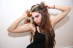 Drunk girl with smeared makeup posing at party Stock Image