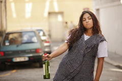 Drunk girl in street Stock Images