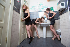 Drunk girl in toilet bars. women in evening Royalty Free Stock Photos