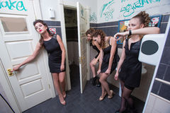 Drunk girl in toilet bars. women in evening Stock Photo