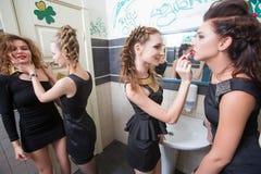 Drunk girl in toilet bars. women in evening Stock Photo