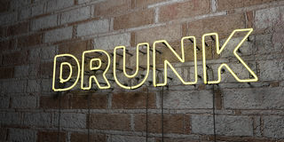 DRUNK - Glowing Neon Sign on stonework wall - 3D rendered royalty free stock illustration Stock Photo