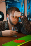 Drunk guy at the bar drinking cognac from glass Stock Photo